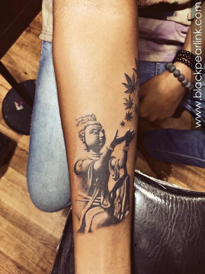 Buddha Sculpture Tattoo on Forearm