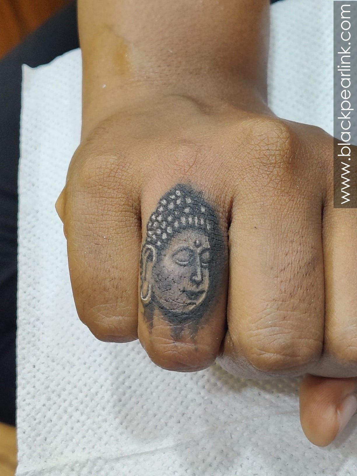 Cute Little Buddha Tattoo on Finger