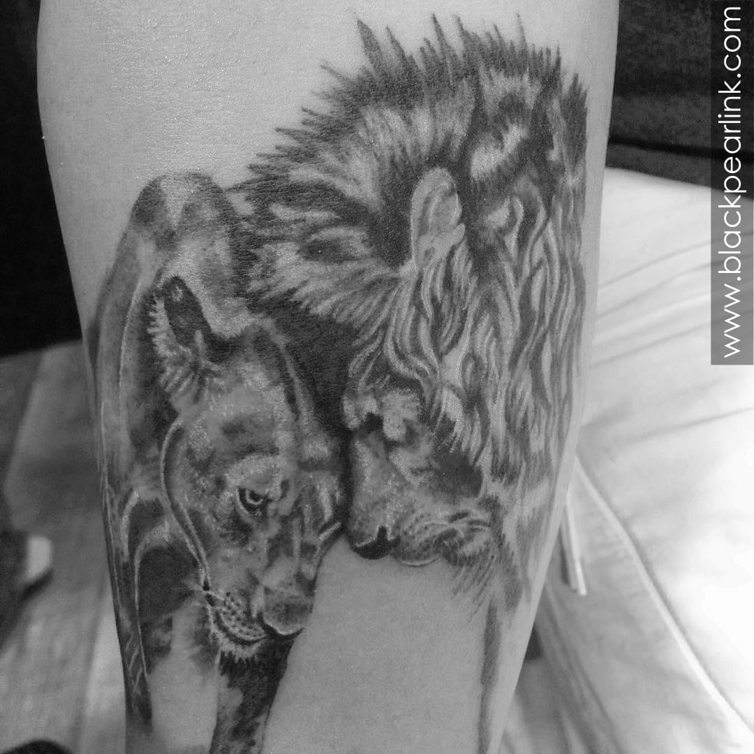 Lion and Lioness in Love Tattoo