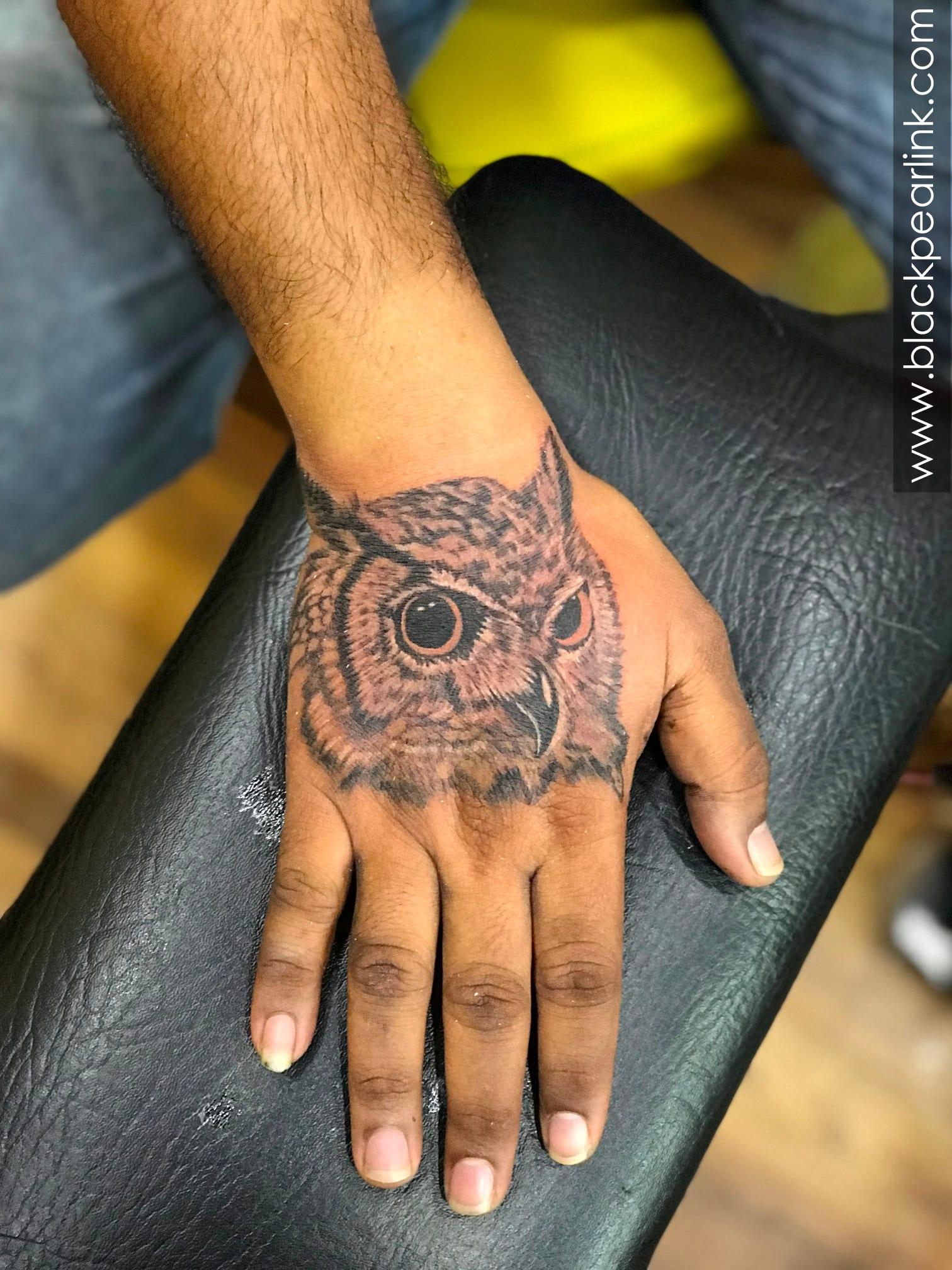 Owl Tattoo on Dorsum of Hand