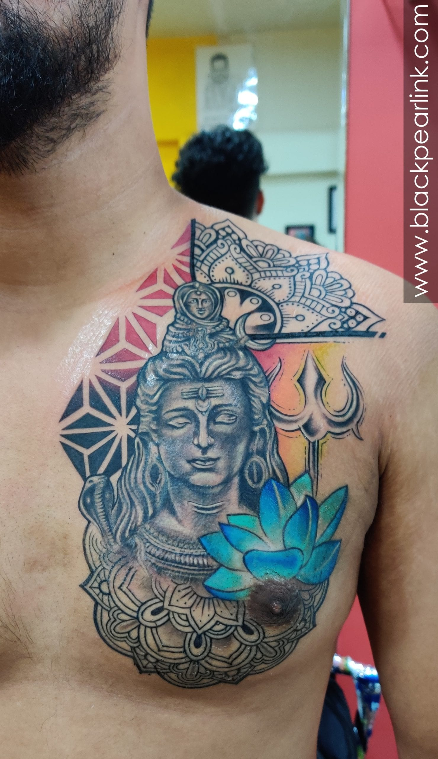 Shiva Tattoo on Chest with Colored Lotus