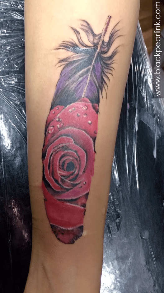 Rose tattoo inside the feather